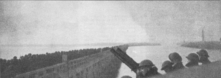 British antiaircraft gunners watch as troops queue up on The Mole - the long breakwater outside Dunkirk Harbor.  Destroyers and larger ships could tie up alongside and load 600 troops in minutes - as opposed to hours spent pulling troops off the beach.