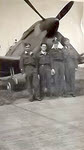 Pilots under nose of No.322 Squadron Spitfire