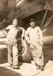 D.G. and Oscar in front of B-17 main wheel