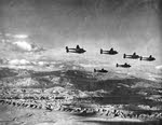 Formation of Lockheed P-38 Lightnings over North Africa