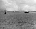 USS Gilmer (APD-11) and USS Zellars (DD-777) at Okinawa, 30 March 1945