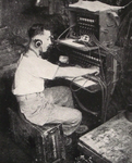 French Naval Gunner operating telephone switchboard, Italy 1944