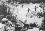 US Soldiers crossing a river, New Guinea