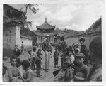 Captain Harold C. James, USAAF, at the temple gates, Kunming (1 of 2)