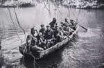 New Zealanders in captured boat, Vella Lavella