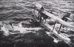 Supermarine Walrus being towed onto towed net